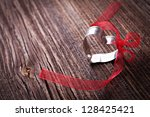heart with bow on brown wood with copy space - stock photo
