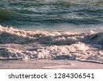 autumn stormy sea on a sunny... | Shutterstock . vector #1284306541