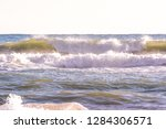 autumn stormy sea on a sunny... | Shutterstock . vector #1284306571