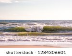 autumn stormy sea on a sunny... | Shutterstock . vector #1284306601