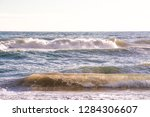 autumn stormy sea on a sunny... | Shutterstock . vector #1284306607