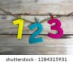 numbers in wood background.... | Shutterstock . vector #1284315931