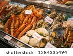 fresh seafood selling at... | Shutterstock . vector #1284335494