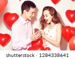 man makes present to his lovely ... | Shutterstock . vector #1284338641