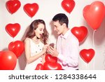 man makes present to his lovely ... | Shutterstock . vector #1284338644