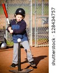 Young Boy Batting At T Ball...