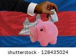 man putting euro into piggy... | Shutterstock . vector #128435024