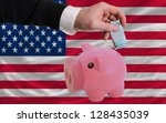 Man putting euro into piggy rich bank and national flag of us in foreign currency because of insecurity and inflation - stock photo