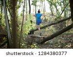 sportswoman cross country trail ...   Shutterstock . vector #1284380377