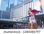 happy beautiful asian woman in... | Shutterstock . vector #1284386797