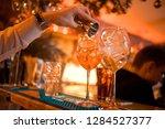 barman pouring fresh alcoholic... | Shutterstock . vector #1284527377