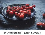 branch of cherry tomatoes on... | Shutterstock . vector #1284569014