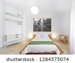 clean bright bedroom with bed ... | Shutterstock . vector #1284575074