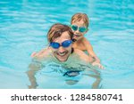 dad and son in swimming goggles ... | Shutterstock . vector #1284580741