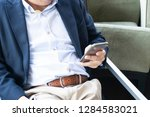 businessman using smartphones...   Shutterstock . vector #1284583021