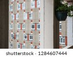 a huge council housing block...   Shutterstock . vector #1284607444