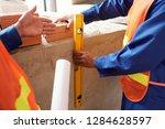 construction worker using... | Shutterstock . vector #1284628597