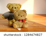 couple brown bear toy sitting...   Shutterstock . vector #1284674827