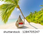 chill lounge zone on the sandy... | Shutterstock . vector #1284705247