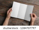 man with blank brochure on... | Shutterstock . vector #1284707797
