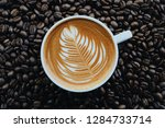 a coffee latte and coffee beans ... | Shutterstock . vector #1284733714