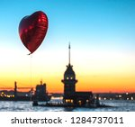 a red heart shaped balloon is... | Shutterstock . vector #1284737011