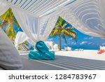 white beach canopies. luxury... | Shutterstock . vector #1284783967