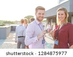 smiling young business couple... | Shutterstock . vector #1284875977