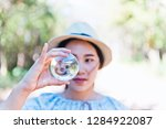 beautiful woman hold crystal...   Shutterstock . vector #1284922087