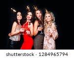 four beautiful elegant women...   Shutterstock . vector #1284965794