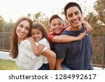 young hispanic parents... | Shutterstock . vector #1284992617