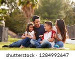 happy young hispanic family... | Shutterstock . vector #1284992647