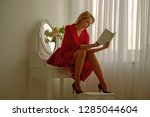 diary reading. woman reading... | Shutterstock . vector #1285044604