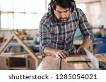focused carpenter wearing... | Shutterstock . vector #1285054021