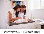 millennial hispanic mother and... | Shutterstock . vector #1285054801