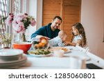 father sitting on a chair and... | Shutterstock . vector #1285060801