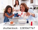 young girl making a cake in the ...   Shutterstock . vector #1285067767