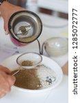 woman cooks ayurvedic ubtan in... | Shutterstock . vector #1285072777