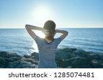women outdoors admire the ocean ... | Shutterstock . vector #1285074481