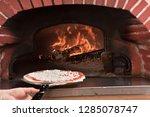 pizza maker pizzaiolo  working... | Shutterstock . vector #1285078747