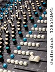 Close up of a multi-channel mixing desk. - stock photo