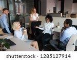 diverse teammate enjoy break... | Shutterstock . vector #1285127914