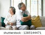 sad senior couple having a... | Shutterstock . vector #1285144471