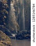 sekumpul waterfall in the green ... | Shutterstock . vector #1285146784
