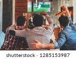 three men watching football on... | Shutterstock . vector #1285153987