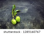 whole small wild green mangoes... | Shutterstock . vector #1285160767