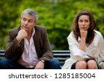 unhappy couple sit next to each ... | Shutterstock . vector #1285185004