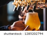 hand of bartender pouring a...   Shutterstock . vector #1285202794