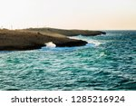 rocky coast  turquoise sea with ... | Shutterstock . vector #1285216924