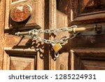 metal chain with a lock on an... | Shutterstock . vector #1285224931